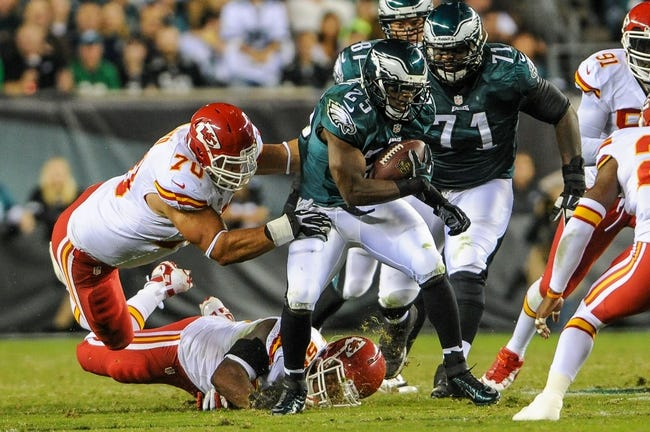 Sep 19, 2013; Philadelphia, PA, USA; Kansas City Chiefs inside linebacker Akeem Jordan (55) and defensive end Mike DeVito (70) tackle Philadelphia Eagles running back LeSean McCoy (25) during the second quarter of the game at Lincoln Financial Field. Mandatory Credit: John Geliebter-USA TODAY Sports