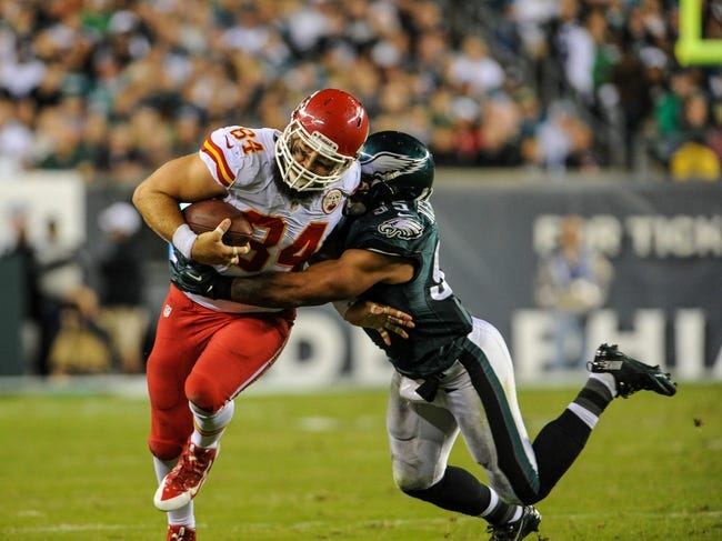 Sep 19, 2013; Philadelphia, PA, USA; Philadelphia Eagles inside linebacker Mychal Kendricks (95) tackles Kansas City Chiefs tight end Sean McGrath (84) during the fourth quarter of the game at Lincoln Financial Field. The Kansas City Chiefs beat the Philadelphia Eagles 26-16. Mandatory Credit: John Geliebter-USA TODAY Sports