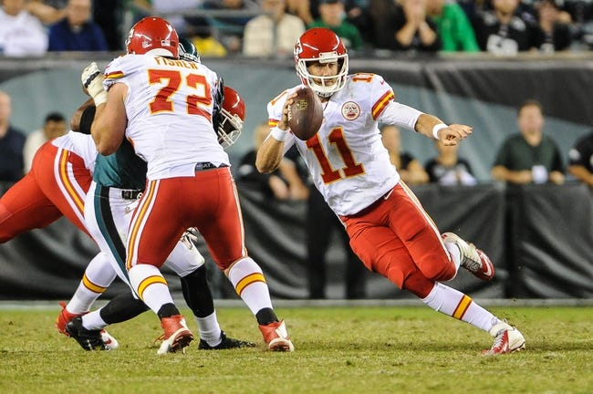 Sep 19, 2013; Philadelphia, PA, USA; Kansas City Chiefs quarterback Alex Smith (11) scrambles during the third quarter of the game against the Philadelphia Eagles at Lincoln Financial Field. The Kansas City Chiefs beat the Philadelphia Eagles 26-16. Mandatory Credit: John Geliebter-USA TODAY Sports