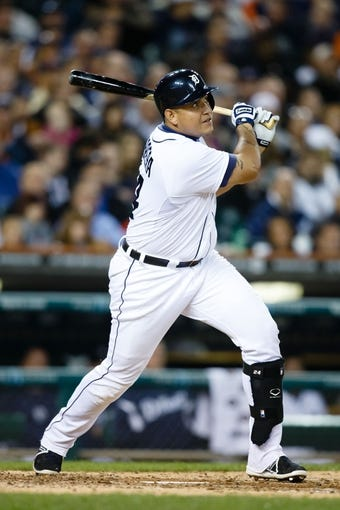 Sep 17, 2013; Detroit, MI, USA; Detroit Tigers third baseman Miguel Cabrera (24) hits a home run in the sixth inning against the Seattle Mariners at Comerica Park. Mandatory Credit: Rick Osentoski-USA TODAY Sports