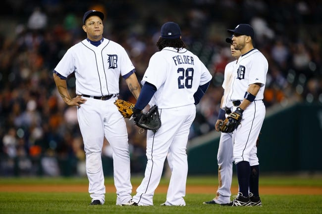 Sep 17, 2013; Detroit, MI, USA; Detroit Tigers third baseman Miguel Cabrera (24) first baseman Prince Fielder (28) shortstop Jose Iglesias (1) and second baseman Omar Infante (4) during the game against the Seattle Mariners at Comerica Park. Mandatory Credit: Rick Osentoski-USA TODAY Sports