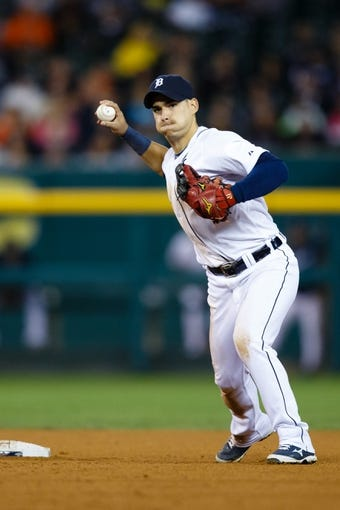 Sep 17, 2013; Detroit, MI, USA; Detroit Tigers shortstop Jose Iglesias (1) makes a throw against the Seattle Mariners at Comerica Park. Mandatory Credit: Rick Osentoski-USA TODAY Sports