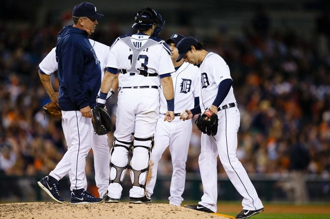 Sep 17, 2013; Detroit, MI, USA; Detroit Tigers pitching coach Jeff Jones (left) talks to starting pitcher Anibal Sanchez (right) against the Seattle Mariners at Comerica Park. Mandatory Credit: Rick Osentoski-USA TODAY Sports
