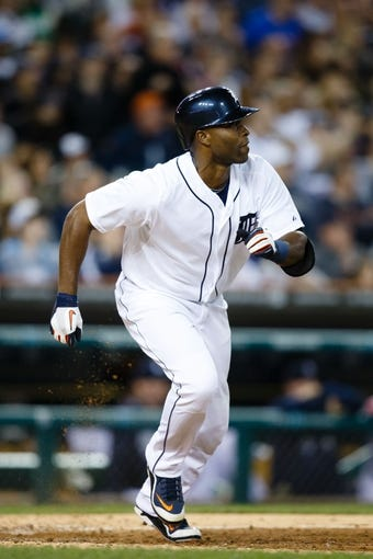 Sep 17, 2013; Detroit, MI, USA; Detroit Tigers right fielder Torii Hunter (48) runs to first against the Seattle Mariners at Comerica Park. Mandatory Credit: Rick Osentoski-USA TODAY Sports
