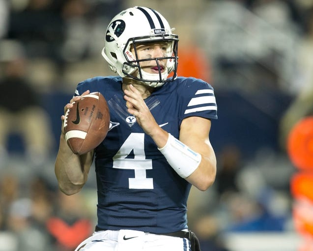 Sep 27, 2013; Provo, UT, USA; Brigham Young Cougars quarterback Taysom Hill (4) looks to pass during the first half against the Middle Tennessee Blue Raiders at Lavell Edwards Stadium. Brigham Young won 37-10. Mandatory Credit: Russ Isabella-USA TODAY Sports