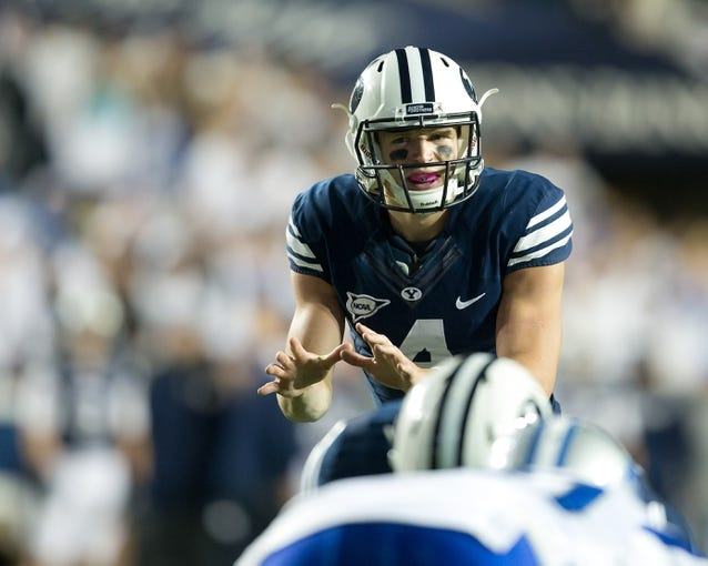 Sep 27, 2013; Provo, UT, USA; Brigham Young Cougars quarterback Taysom Hill (4) awaits the snap prior to a play during the first half against the Middle Tennessee Blue Raiders at Lavell Edwards Stadium. Brigham Young won 37-10. Mandatory Credit: Russ Isabella-USA TODAY Sports