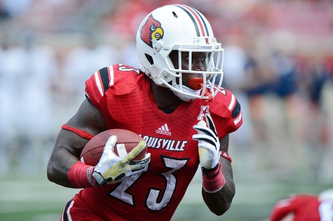 Sep 21, 2013; Louisville, KY, USA; Louisville Cardinals running back Brandon Radcliff (23) runs the ball against the Fiu Golden Panthers during the second half of play at Papa John's Cardinal Stadium. Louisville defeated FIU 72-0.  Mandatory Credit: Jamie Rhodes-USA TODAY Sports