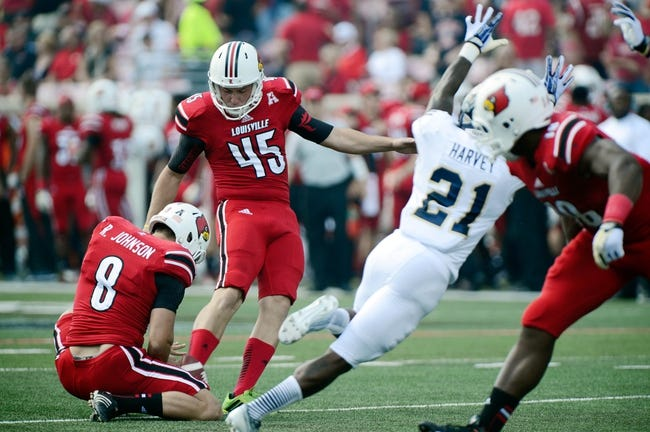 Sep 21, 2013; Louisville, KY, USA; Louisville Cardinals punter John Wallace (45) kicks a point after attempt against the FIU Golden Panthers during the second quarter of play at Papa John's Cardinal Stadium. Louisville defeated FIU 72-0.  Mandatory Credit: Jamie Rhodes-USA TODAY Sports