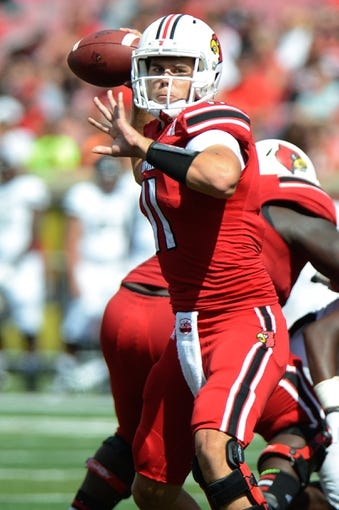 Sep 21, 2013; Louisville, KY, USA; Louisville Cardinals quarterback Will Gardner (11) looks to pass during the second half of play against the FIU Golden Panthers at Papa John's Cardinal Stadium. Louisville defeated FIU 72-0.  Mandatory Credit: Jamie Rhodes-USA TODAY Sports