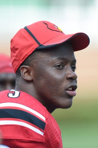 Sep 21, 2013; Louisville, KY, USA; Louisville Cardinals quarterback Teddy Bridgewater (5) watches from the sidelines during the second half of play against the FIU Golden Panthers at Papa John's Cardinal Stadium. Louisville defeated FIU 72-0.  Mandatory Credit: Jamie Rhodes-USA TODAY Sports