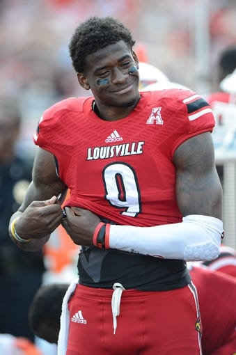 Sep 21, 2013; Louisville, KY, USA; Louisville Cardinals wide receiver DeVante Parker (9) watches from the sidelines during the second half of play against the FIU Golden Panthers at Papa John's Cardinal Stadium. Louisville defeated FIU 72-0.  Mandatory Credit: Jamie Rhodes-USA TODAY Sports