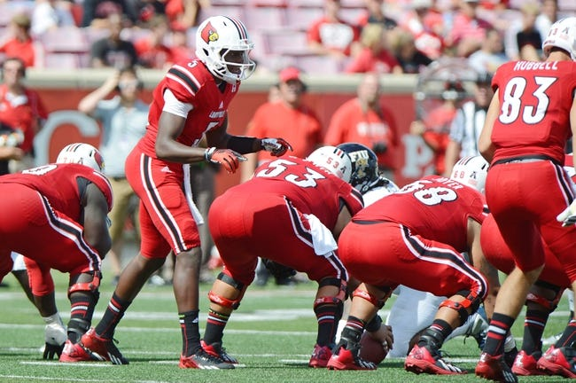 Sep 21, 2013; Louisville, KY, USA; Louisville Cardinals quarterback Teddy Bridgewater (5) calls a play at the line scrimmage during the second half of play against the FIU Golden Panthers at Papa John's Cardinal Stadium. Louisville defeated FIU 72-0.  Mandatory Credit: Jamie Rhodes-USA TODAY Sports