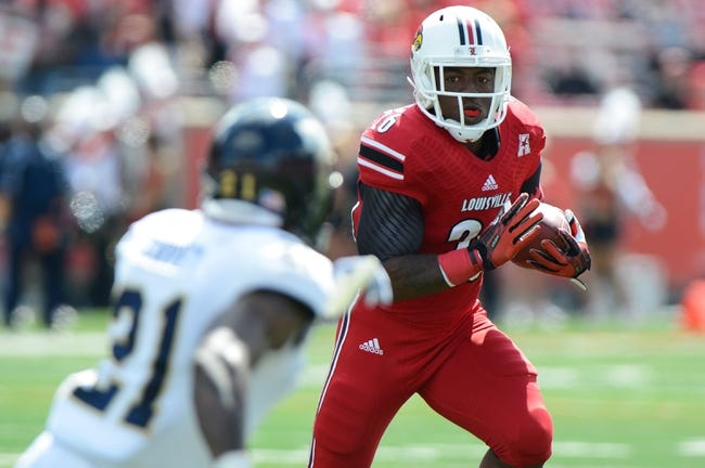 Sep 21, 2013; Louisville, KY, USA; Louisville Cardinals running back Michael Dyer (26) runs the ball against the FIU Golden Panthers during the second quarter of play at Papa John's Cardinal Stadium. Louisville defeated FIU 72-0.  Mandatory Credit: Jamie Rhodes-USA TODAY Sports