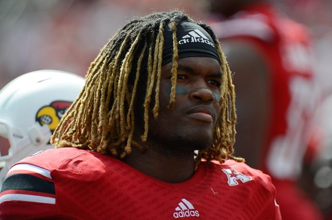 Sep 21, 2013; Louisville, KY, USA; Louisville Cardinals defensive end Lorenzo Mauldin (94) looks on from the sidelines during the first quarter of play against the FIU Golden Panthers at Papa John's Cardinal Stadium. Louisville defeated FIU 72-0.  Mandatory Credit: Jamie Rhodes-USA TODAY Sports