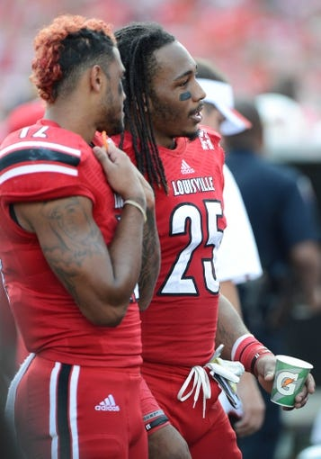Sep 21, 2013; Louisville, KY, USA; Louisville Cardinals safety Calvin Pryor (25) watches from the sidelines during the second half of play against the FIU Golden Panthers at Papa John's Cardinal Stadium. Louisville defeated FIU 72-0.  Mandatory Credit: Jamie Rhodes-USA TODAY Sports