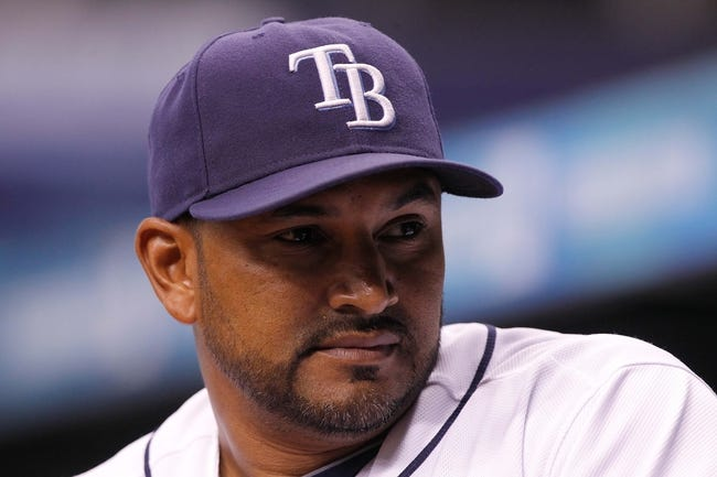 Sep 16, 2013; St. Petersburg, FL, USA; Tampa Bay Rays bench coach Dave Martinez (4) against the Texas Rangers at Tropicana Field. Tampa Bay Rays defeated the Texas Rangers 6-2. Mandatory Credit: Kim Klement-USA TODAY Sports
