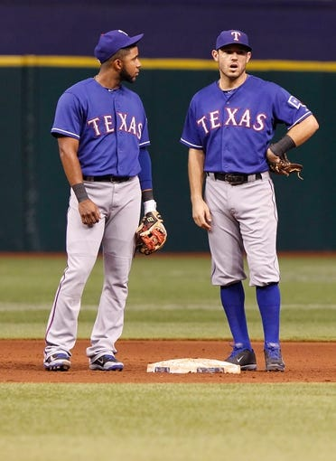 Sep 16, 2013; St. Petersburg, FL, USA; Texas Rangers shortstop Elvis Andrus (1) and second baseman Ian Kinsler (5) talk against the Tampa Bay Rays at Tropicana Field. Mandatory Credit: Kim Klement-USA TODAY Sports