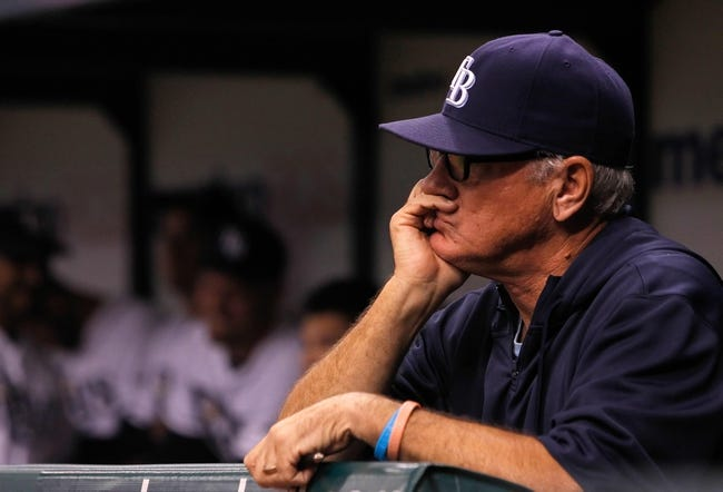 Sep 16, 2013; St. Petersburg, FL, USA; Tampa Bay Rays manager Joe Maddon (70) in the dugout against the Texas Rangers at Tropicana Field. Mandatory Credit: Kim Klement-USA TODAY Sports