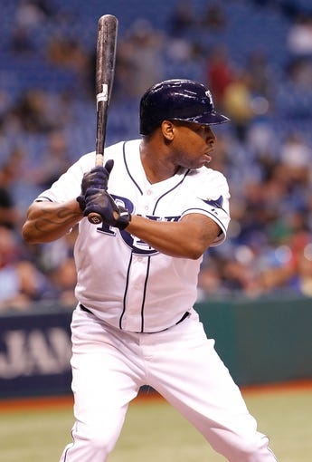 Sep 16, 2013; St. Petersburg, FL, USA; Tampa Bay Rays designated hitter Delmon Young (15) at bat against the Texas Rangers at Tropicana Field. Tampa Bay Rays defeated the Texas Rangers 6-2. Mandatory Credit: Kim Klement-USA TODAY Sports
