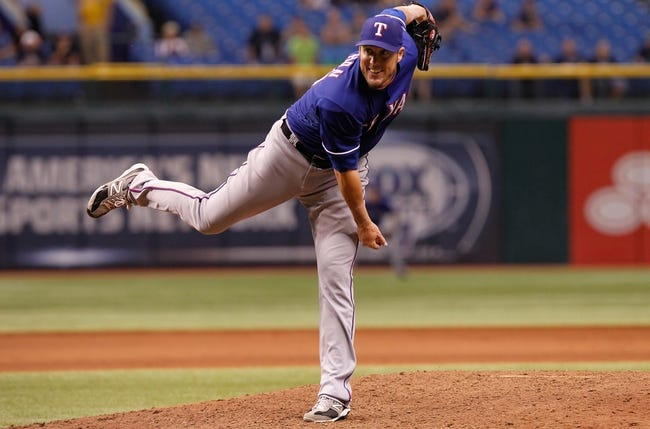 Sep 18, 2013; St. Petersburg, FL, USA; Texas Rangers relief pitcher Joe Nathan (36) throws a pitch against the Tampa Bay Rays at Tropicana Field. Tampa Bay Rays defeated the Texas Rangers 4-3 in twelve inning. Mandatory Credit: Kim Klement-USA TODAY Sports