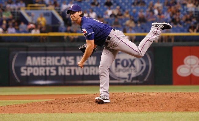 Sep 18, 2013; St. Petersburg, FL, USA; Texas Rangers relief pitcher Neal Cotts (56) throws a pitch against the Tampa Bay Rays at Tropicana Field. Mandatory Credit: Kim Klement-USA TODAY Sports
