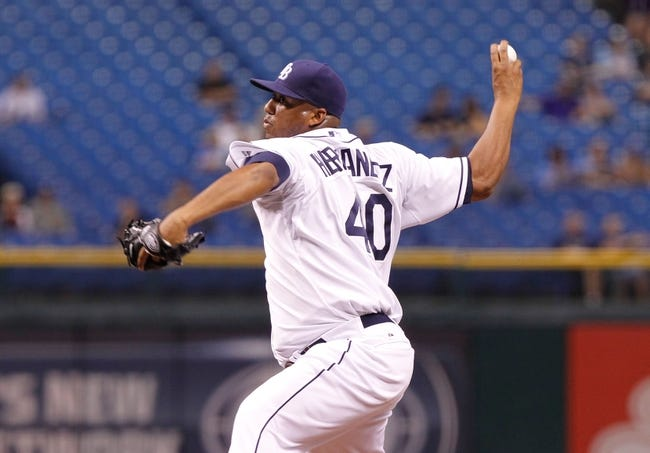 Sep 18, 2013; St. Petersburg, FL, USA; Tampa Bay Rays starting pitcher Roberto Hernandez (40) throws a pitch against the Texas Rangers at Tropicana Field. Tampa Bay Rays defeated the Texas Rangers 4-3 in twelve inning. Mandatory Credit: Kim Klement-USA TODAY Sports