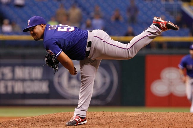 Sep 18, 2013; St. Petersburg, FL, USA; Texas Rangers relief pitcher Joe Ortiz (58) throws a pitch during the twelfth inning against the Tampa Bay Rays at Tropicana Field. Tampa Bay Rays defeated the Texas Rangers 4-3 in twelve inning. Mandatory Credit: Kim Klement-USA TODAY Sports