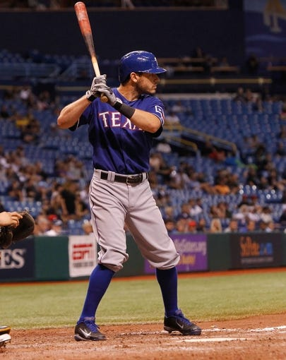 Sep 18, 2013; St. Petersburg, FL, USA; Texas Rangers second baseman Ian Kinsler (5) at bat against the Tampa Bay Rays at Tropicana Field. Tampa Bay Rays defeated the Texas Rangers 4-3 in twelve inning. Mandatory Credit: Kim Klement-USA TODAY Sports