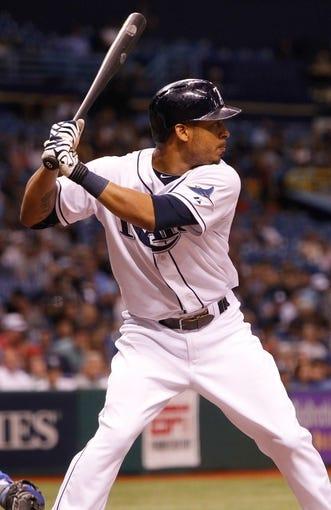 Sep 18, 2013; St. Petersburg, FL, USA; Tampa Bay Rays center fielder Desmond Jennings (8) at bat against the Texas Rangers at Tropicana Field. Mandatory Credit: Kim Klement-USA TODAY Sports