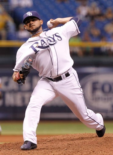 Sep 18, 2013; St. Petersburg, FL, USA; Tampa Bay Rays relief pitcher Alex Torres (54) throws a pitch against the Texas Rangers at Tropicana Field. Tampa Bay Rays defeated the Texas Rangers 4-3 in twelve inning. Mandatory Credit: Kim Klement-USA TODAY Sports