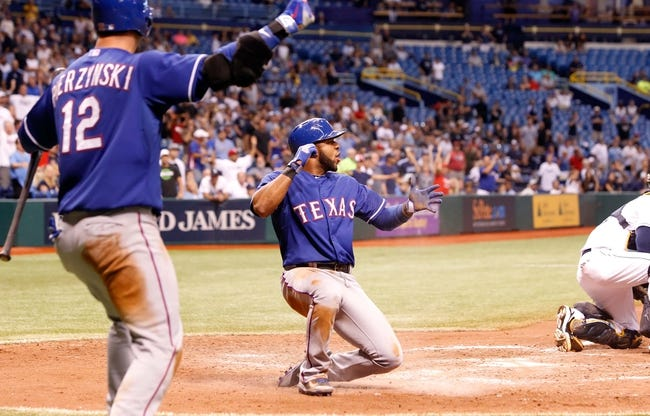 Sep 18, 2013; St. Petersburg, FL, USA; Texas Rangers shortstop Elvis Andrus (1) slides into home plate during the eleventh inning against the Tampa Bay Rays at Tropicana Field. Mandatory Credit: Kim Klement-USA TODAY Sports