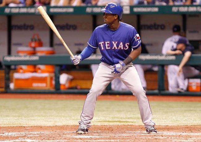 Sep 18, 2013; St. Petersburg, FL, USA; Texas Rangers second baseman Jurickson Profar (13) at bat against the Tampa Bay Rays at Tropicana Field. Mandatory Credit: Kim Klement-USA TODAY Sports