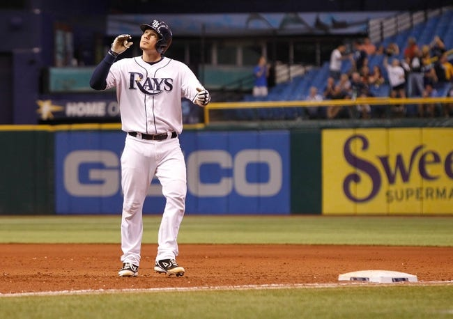 Sep 18, 2013; St. Petersburg, FL, USA; Tampa Bay Rays catcher Jose Lobaton (59) reacts after he singled against the Texas Rangers at Tropicana Field. Tampa Bay Rays defeated the Texas Rangers 4-3 in twelve inning. Mandatory Credit: Kim Klement-USA TODAY Sports