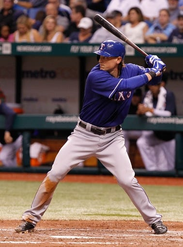 Sep 18, 2013; St. Petersburg, FL, USA; Texas Rangers center fielder Jim Adduci (35) at bat against the Tampa Bay Rays at Tropicana Field. Mandatory Credit: Kim Klement-USA TODAY Sports