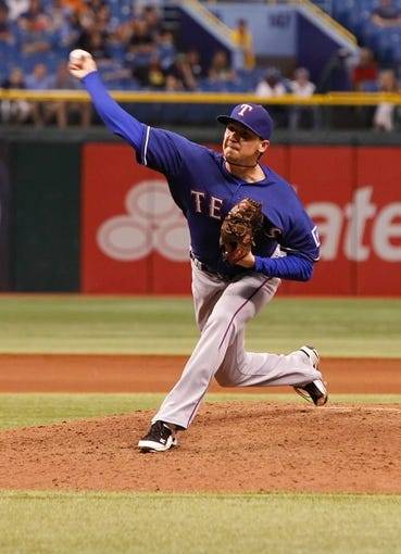 Sep 18, 2013; St. Petersburg, FL, USA; Texas Rangers relief pitcher Tanner Scheppers (52) throws a pitch against the Tampa Bay Rays at Tropicana Field. Mandatory Credit: Kim Klement-USA TODAY Sports