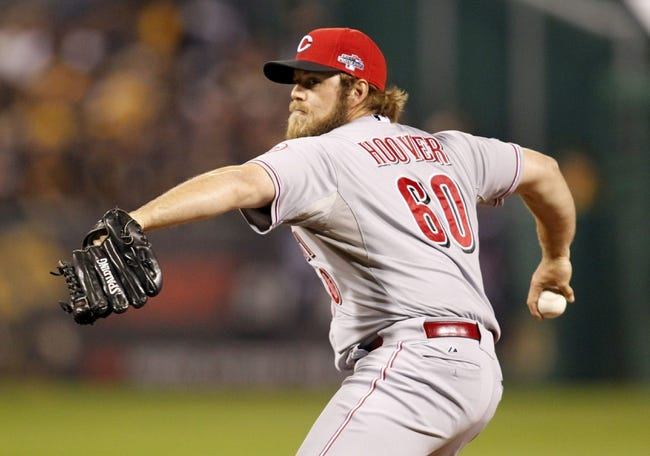 Oct 1, 2013; Pittsburgh, PA, USA; Cincinnati Reds relief pitcher J.J. Hoover throws a pitch against the Pittsburgh Pirates in the fourth inning of the National League wild card playoff baseball game at PNC Park. Mandatory Credit: Charles LeClaire-USA TODAY Sports