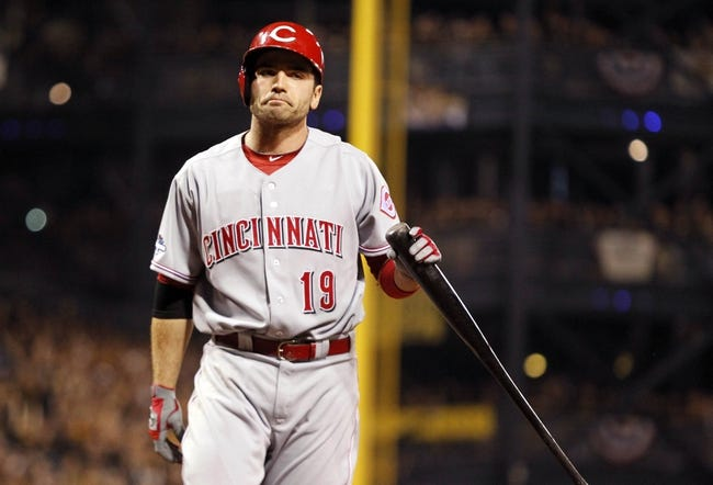 Oct 1, 2013; Pittsburgh, PA, USA; Cincinnati Reds first baseman Joey Votto (19) reacts after striking out against the Pittsburgh Pirates in the sixth inning of the National League wild card playoff baseball game at PNC Park. The Pirates won 6-2. Mandatory Credit: Charles LeClaire-USA TODAY Sports