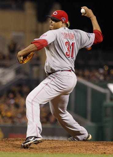 Oct 1, 2013; Pittsburgh, PA, USA; Cincinnati Reds relief pitcher Alfredo Simon (31) throws a pitch in the fifth inning of the National League wild card playoff baseball game at PNC Park. The Pirates won 6-2. Mandatory Credit: Charles LeClaire-USA TODAY Sports