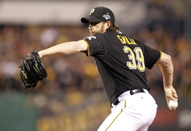Oct 1, 2013; Pittsburgh, PA, USA; Pittsburgh Pirates relief pitcher Jason Grilli (39) throws a pitch against the Cincinnati Reds in the ninth inning of the National League wild card playoff baseball game at PNC Park. The Pirates won 6-2. Mandatory Credit: Charles LeClaire-USA TODAY Sports