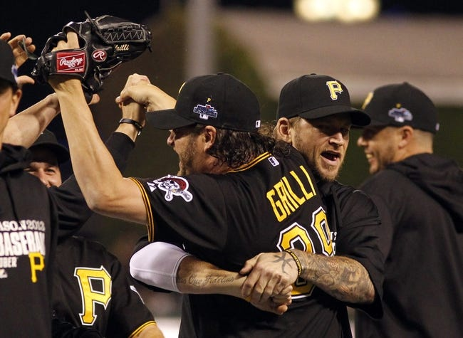 Oct 1, 2013; Pittsburgh, PA, USA; Pittsburgh Pirates relief pitcher Jason Grilli (39) gets a hug from teammate A.J. Burnett after defeating the Cincinnati Reds in the National League wild card playoff baseball game at PNC Park. The Pirates won 6-2. Mandatory Credit: Charles LeClaire-USA TODAY Sports