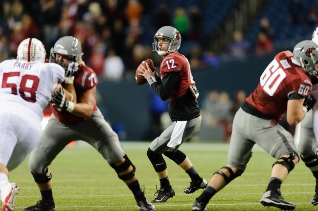 Sep 28, 2013; Seattle, WA, USA; Washington State Cougars quarterback Connor Halliday (12) looks for an open receiver during the game against the Stanford Cardinal at CenturyLink Field. Stanford defeated Washington State 55-17. Mandatory Credit: Steven Bisig-USA TODAY Sports