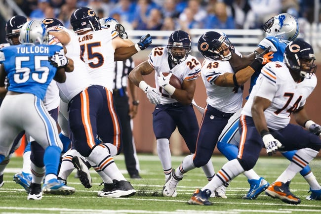 Sep 29, 2013; Detroit, MI, USA; Chicago Bears running back Matt Forte (22) runs the ball against the Detroit Lions at Ford Field. Mandatory Credit: Rick Osentoski-USA TODAY Sports
