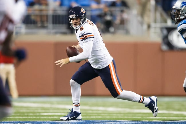 Sep 29, 2013; Detroit, MI, USA; Chicago Bears quarterback Jay Cutler (6) rolls out against the Detroit Lions at Ford Field. Mandatory Credit: Rick Osentoski-USA TODAY Sports