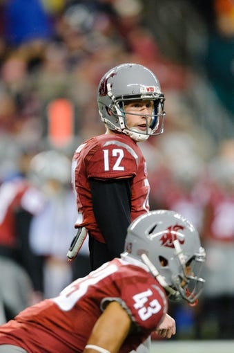 Sep 28, 2013; Seattle, WA, USA; Washington State Cougars quarterback Connor Halliday (12) during the game against the Stanford Cardinal at CenturyLink Field. Stanford defeated Washington State 55-17. Mandatory Credit: Steven Bisig-USA TODAY Sports