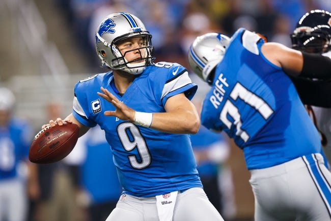 Sep 29, 2013; Detroit, MI, USA; Detroit Lions quarterback Matthew Stafford (9) passes the ball against the Chicago Bears at Ford Field. Mandatory Credit: Rick Osentoski-USA TODAY Sports