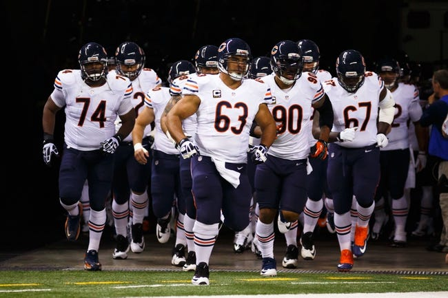 Sep 29, 2013; Detroit, MI, USA; Chicago Bears center Roberto Garza (63) leads on the team before the game against the Detroit Lions at Ford Field. Mandatory Credit: Rick Osentoski-USA TODAY Sports