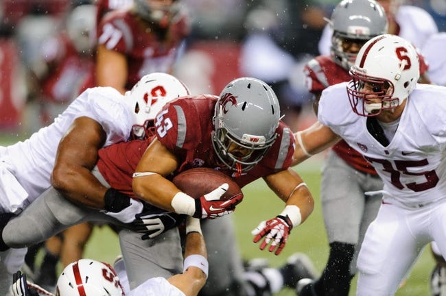 Sep 28, 2013; Seattle, WA, USA; Washington State Cougars running back Jeremiah Laufasa (43) carries the ball against the Stanford Cardinal at CenturyLink Field. Stanford defeated Washington State 55-17. Mandatory Credit: Steven Bisig-USA TODAY Sports