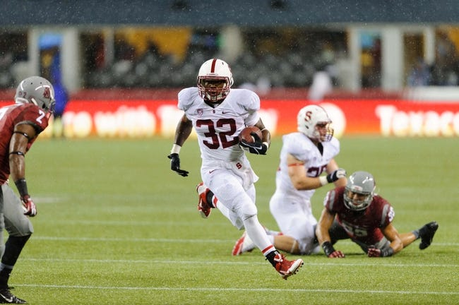 Sep 28, 2013; Seattle, WA, USA; Stanford Cardinal running back Anthony Wilkerson (32) carries the ball against the Washington State Cougars during the game at CenturyLink Field. Stanford defeated Washington State 55-17. Mandatory Credit: Steven Bisig-USA TODAY Sports