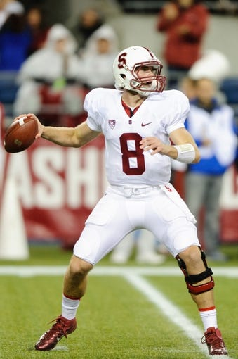Sep 28, 2013; Seattle, WA, USA; Stanford Cardinal quarterback Kevin Hogan (8) looks to pass the ball during the game against the Washington State Cougars at CenturyLink Field. Stanford defeated Washington State 55-17. Mandatory Credit: Steven Bisig-USA TODAY Sports