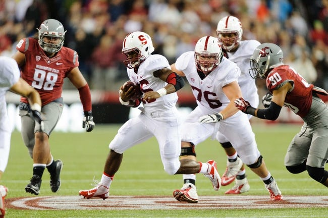 Sep 28, 2013; Seattle, WA, USA; Stanford Cardinal running back Barry Sanders (26) carries the ball against the Washington State Cougars at CenturyLink Field. Stanford defeated Washington State 55-17. Mandatory Credit: Steven Bisig-USA TODAY Sports